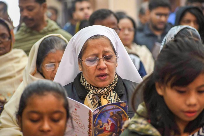 Devotees attend the mass prayers on the occasion of Christmas at Katholik Church, in Patna on Dec 25, 2018. PTI