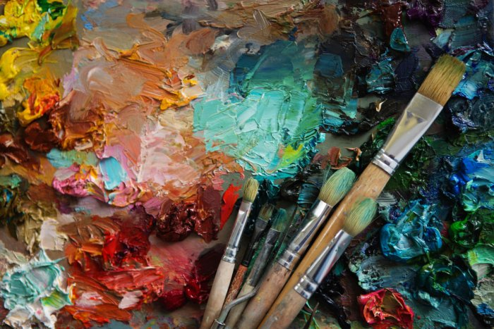 artists brushes and oil paints on wooden palette. Vintage stylized photo of paintbrushes closeup and artist palette. palette with paintbrush and palette-knifeYouth and Social Media