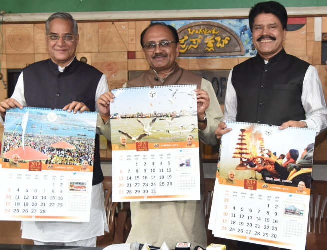 Uttar Pradesh, Medical and Health Minister Siddharth Nath Singh launch Kumbh 2019 calendar at a press conference at Press Club in Bengaluru on Wednesday 26th December 2018. MLC Lehar Singh and FICCI member Jacob Crasta are also seen. DH Photo/Janardhan B