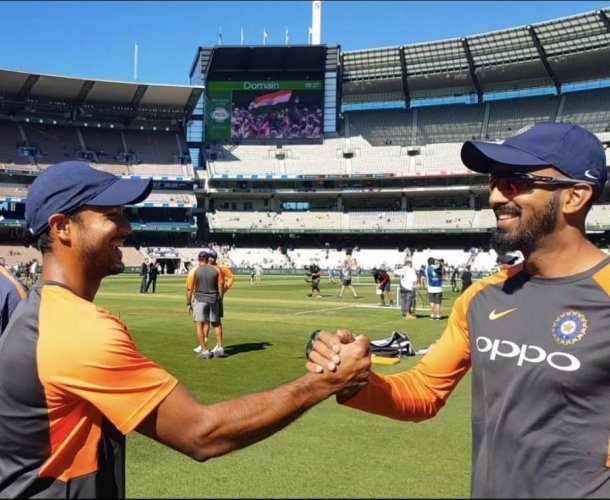 KL Rahul congratulates Karnataka and India teammate Mayank Agarwal after the latter received the Test cap from skipper Virat Kohli in Melbourne on Wednesday.