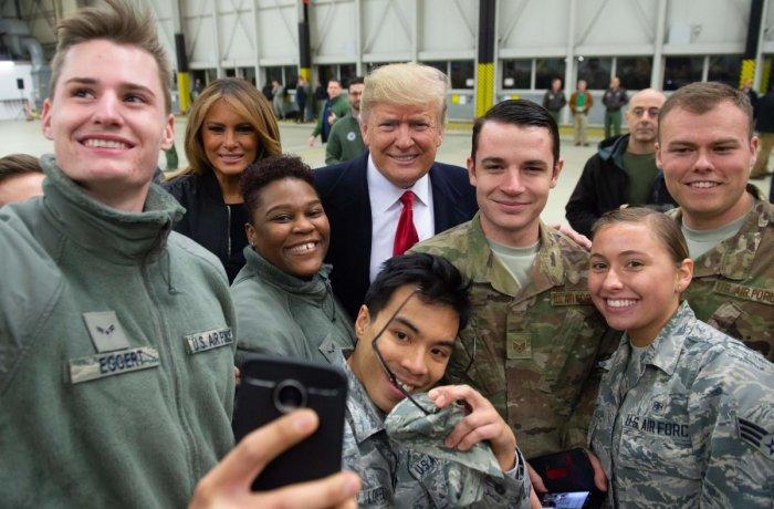 US President Donald Trump and First Lady Melania Trump greet members of the US military during a stop at Ramstein Air Base in Germany, on December 27, 2018. (AFP Photo)