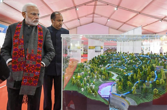 Prime Minister Narendra Modi along with Chief Minister Jai Ram Thakur visits an exhibition at Dharamshala in Himachal Pradesh. (PIB Photo via PTI)