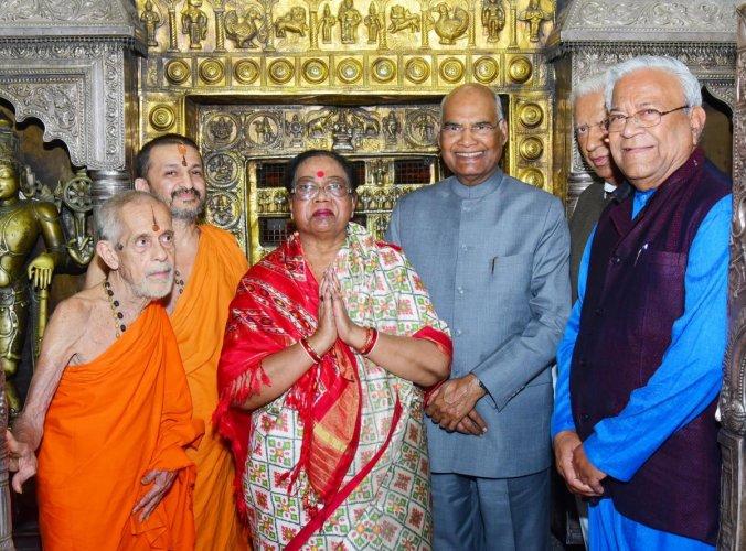 President Ram Nath Kovind, along with his wife Savita Kovind, poses after having the darshan of Lord Krishna at Sri Krishna Temple in Udupi on Thursday. Pejawar Mutt Pontiff Vishwesha Teertha Swami, Paryaya Palimar Pontiff Vidyadeesha Swami and others loo