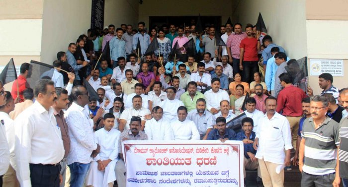 Members of Kodagu District Roman Catholic Association stage a protest in front of the DC's office in Madikeri on Friday.