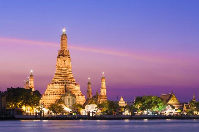 The illuminated temple of Wat Arun on the Chao Phraya river, Bangkok, Thailand