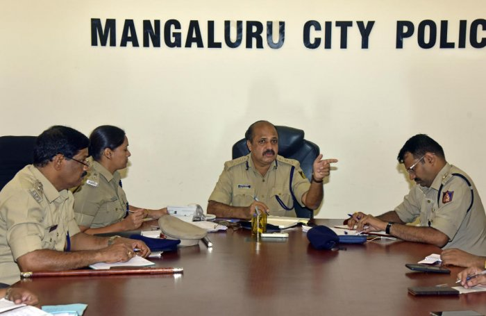 City Police Commissioner T R Suresh speaks during a phone-in programme held at the office of the Commissionerate of Police in Mangaluru.