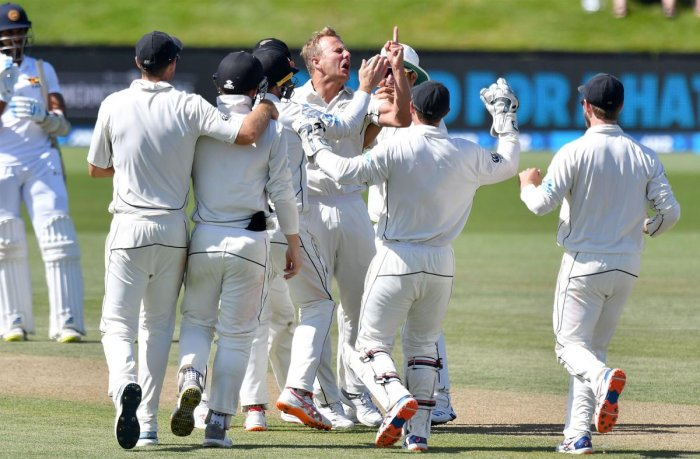 BOUNCING LANKANS OUT: New Zealand's Neil Wagner (centre) celebrates with team-mates after dismissing Sri Lanka's Dinesh Chandimal on Saturday. AFP