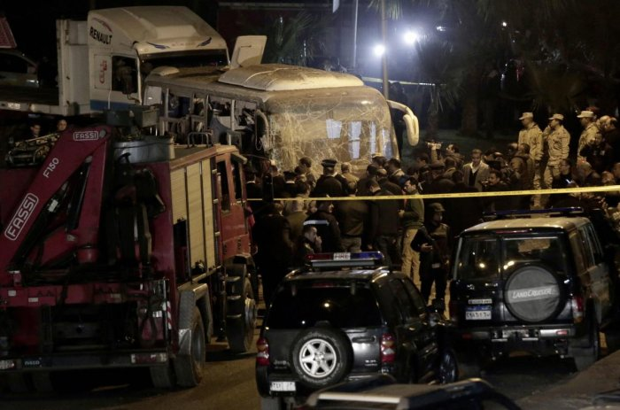 Security forces stand near a tourist bus after a roadside bomb in an area near the Giza Pyramids in Cairo, Egypt. Egypt's Interior Ministry said in a statement that two Vietnamese tourists were killed and others wounded, in the incident. AP/PTI