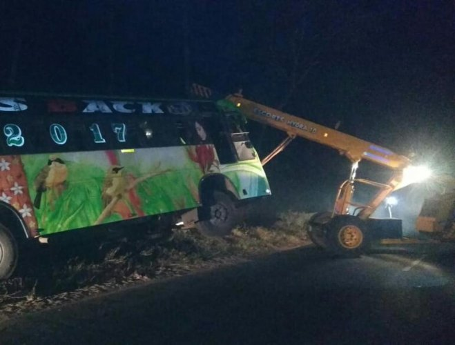 The private bus that met with an accident was lifted using a crane at Shanthigeri near Suntikoppa in Kodagu district.
