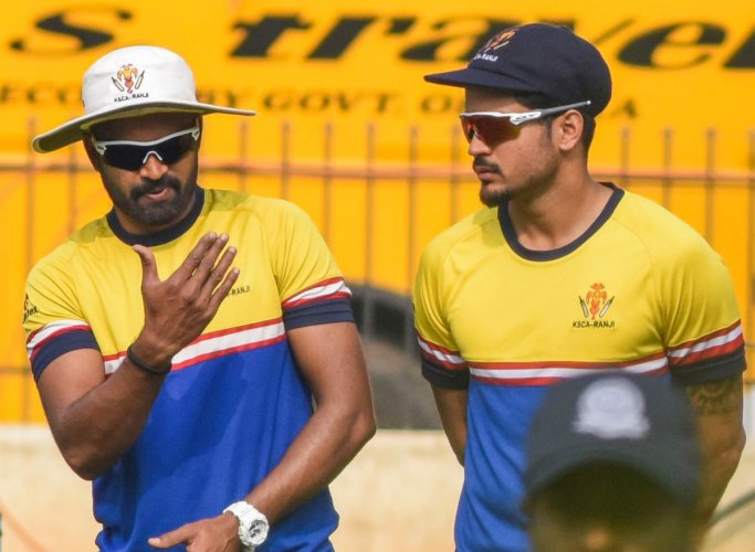 YOUR TURN MATE: R Vinay Kumar (left) with Manish Pandey, who has been named as Karnataka's captain, at a training session. DH PHOTO/ SK DINESH