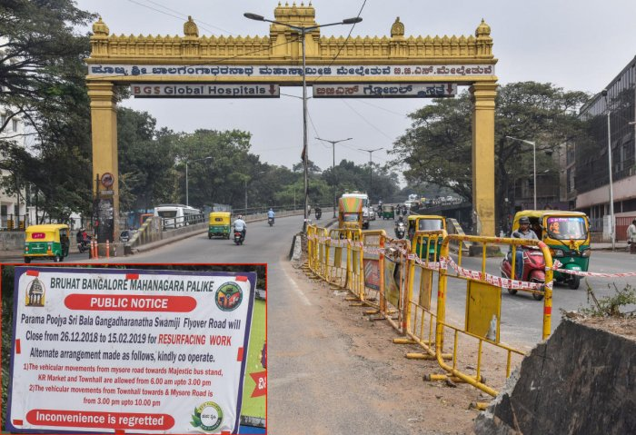 The BBMP has removed the road divider and put barricades on the Sirsi Circle flyover to facilitate the resurfacing work on Saturday. dh Photo/S K Dinesh