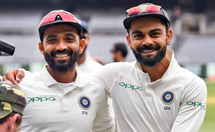 India's captain Virat Kohli (R) and Ajinkya Rahane (L) celebrate on the final day of the third cricket Test match between Australia and India in Melbourne on December 30, 2018. (Photo by WILLIAM WEST / AFP)