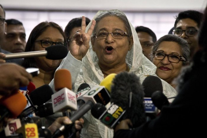 Bangladesh Prime Minister Sheikh Hasina flashes a victory sign as she speaks to the media persons. (AP/PTI)