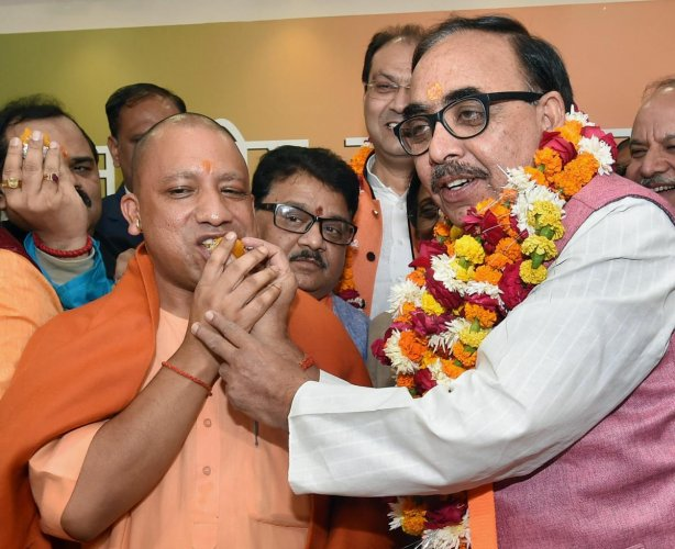 Lucknow: Uttar Pradesh Chief Minister Yogi Adityanath and BJP state president Mahendra Nath Pandey celebrate the victory of the party in the state civic body elections at the party office in Lucknow on Friday. PTI Photo by Nand Kumar(PTI12_1_2017_000138B)
