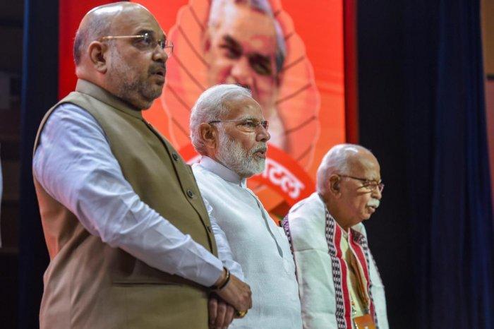 New Delhi: Prime Minister Narendra Modi, BJP President Amit Shah and BJP senior leader LK Advani during BJP National Executive Meet, in New Delhi, Saturday, Sept 8, 2018. (PTI Photo/Atul Yadav) (PTI9_8_2018_000097A)