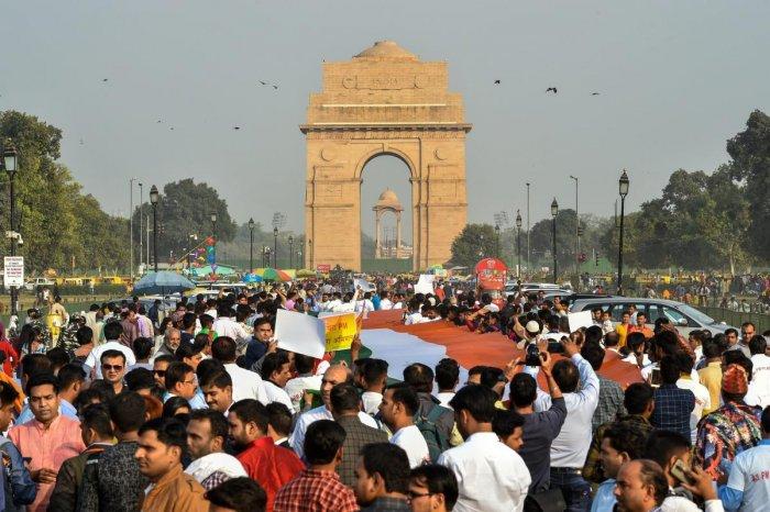 BJP supporters participate in 'Mera PM Mera Abhiman' campaign at India Gate in New Delhi, on Sunday. PTI