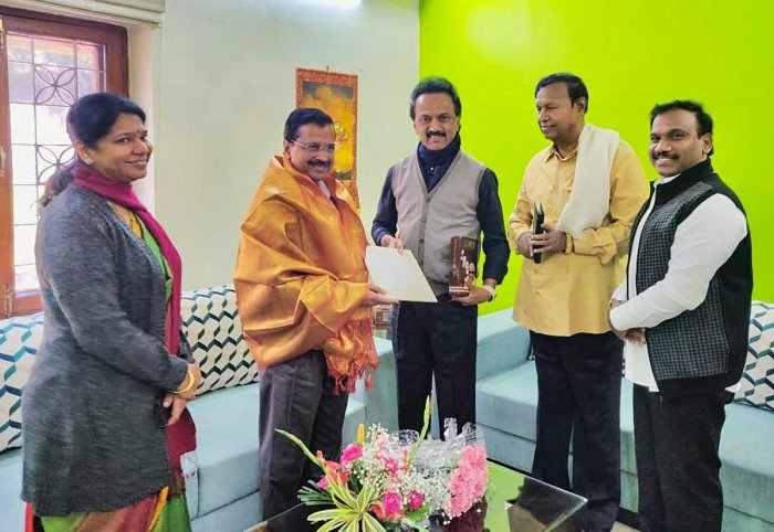 DMK president M K Stalin invites Delhi Chief Minister Arvind Kejriwal for the inauguration ceremony of the statue of M Karunanidhi in Chennai on Monday. DMK party leaders M K Kanimozhi, A Raja and T R Balu are also seen. PTI