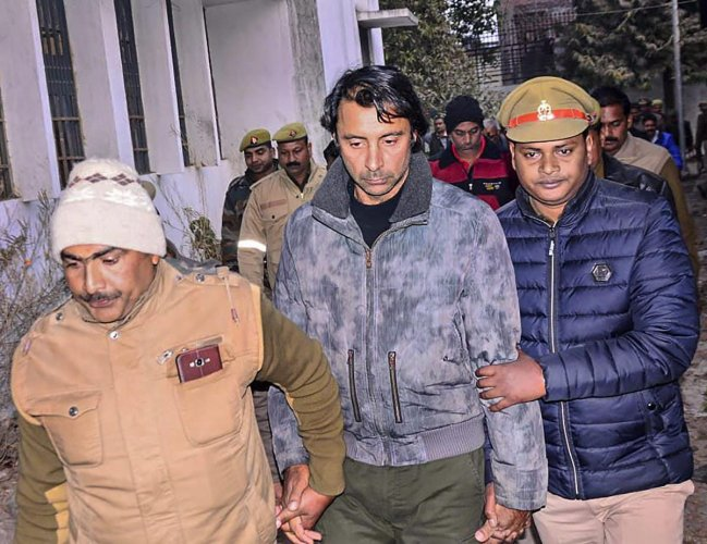 Ace golfer Jyoti Randhawa, who was arrested on charges of poaching in the Dudhwa Tiger Reserve's protected area, being taken to a court in Bahraich, Uttar Pradesh on December 26, 2018. PTI
