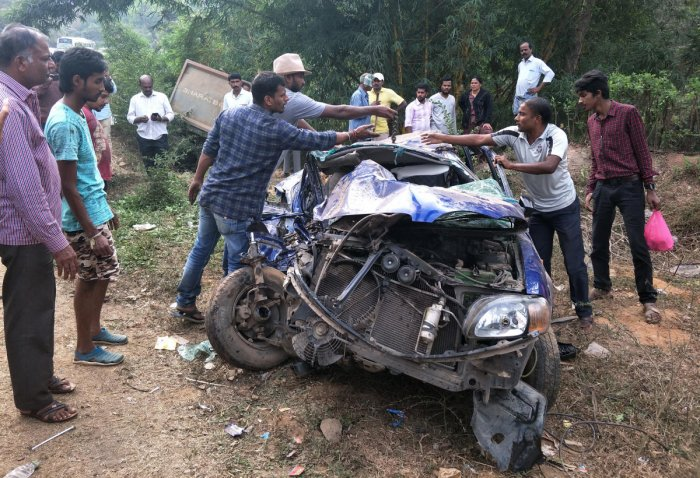 Mangled remains of the car involved in an accident on the Bengaluru-Mangaluru national highway near Donigal on Sunday.