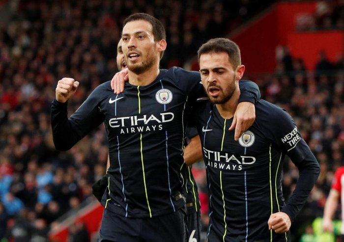 Manchester City's David Silva (left) celebrates with team-mate Bernardo Silva after scoring against Southampton on Sunday. Reuters