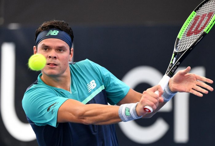 IN CONTROL: Canada's Milos Raonic hits a return during his win over Slovakia's Aljaz Bedene in the Brisbane International on Monday. AFP