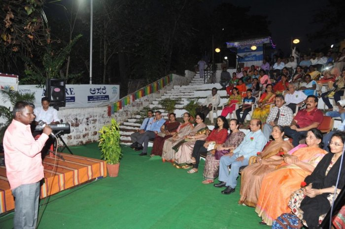 A visually impaired person performs during a musical evening in Manipal.