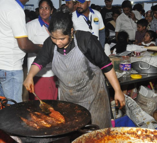 Fish delicacies being prepared during the Matsyamela on Malpe beach.