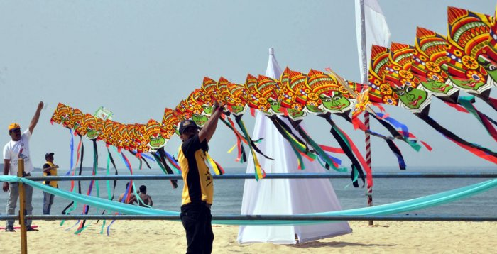 Kite flyers prepare for the festival at Malpe beach on Monday.