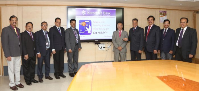 Karnataka Bank MD and CEO Mahabaleshwara M S, Non-executive Chairman P Jayaram Bhat and others at the launch of KBL Mobile Plus in Mangaluru on Tuesday.