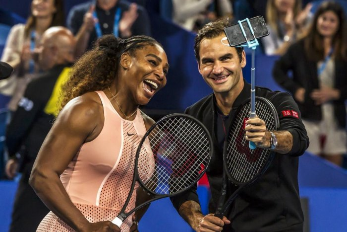 US' Serena Williams (left) and Roger Federer of Switzerland take a selfie after their mixed doubles match in Perth on Tuesday. AFP