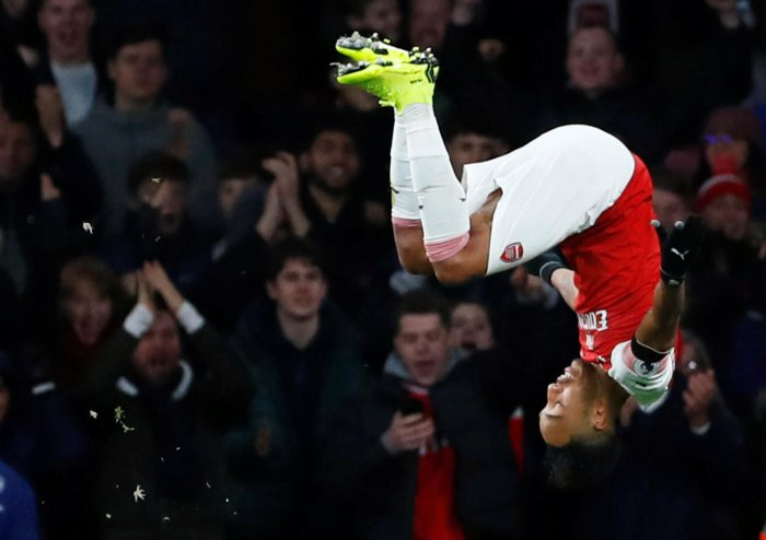 LEAP OF JOY: Arsenal's Pierre-Emerick Aubameyang celebrates after scoring against Fulham on Tuesday. REUTERS