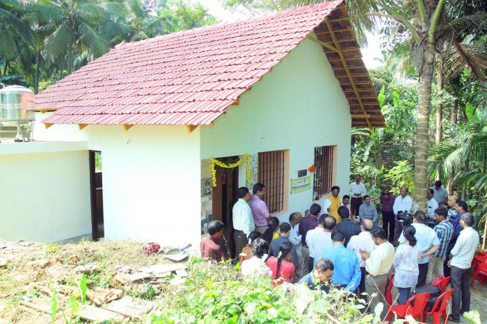 Suresh and his family at their new house in Kannur.
