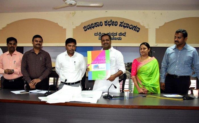 District In-charge Minister U T Khader unveils the logo of the river fest at the deputy commissioner's office in Mangaluru on Tuesday.