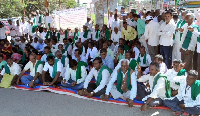 Farmers stage a protest in Chikkamagaluru on Wednesday.