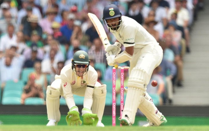 India batsman Cheteshwar Pujara hits a ball on the first day of the fourth and final Test against Australia at the Sydney Cricket Ground in Sydney on January 3, 2019. (AFP Photo)