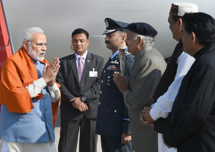 Prime Minister Narendra Modi being received by Punjab Governor VP Singh Badnore on his arrival, in Jalandhar. PTI photo