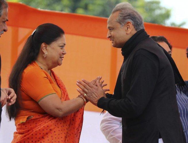 Rajasthan Chief Minister Ashok Gehlot and former chief minister Vasundhara Raje. (PTI Photo)