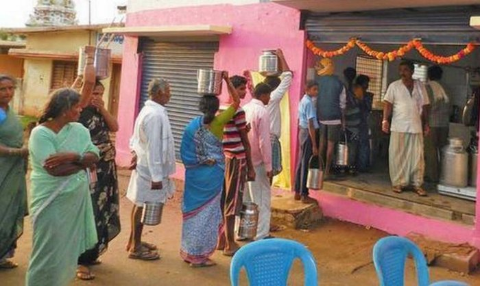 Farmers supply milk to a dairy in a village in Mandya district. DH file photo