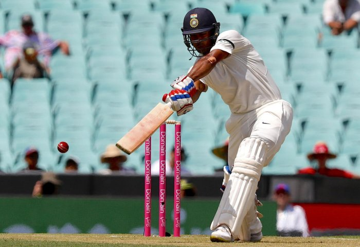 India's Mayank Agarwal hits a boundary during the first day of the fourth and final cricket Test against Australia at the Sydney Cricket Ground in Sydney on January 3, 2019. (AFP Photo)