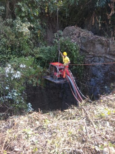 An Odisha fire service personnel struggles to install a water pump near the Meghalaya mining mishap site on Thursday. Photo credit/East Jaintia Hills district administration, Meghalaya