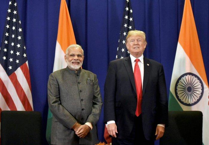 Manila: Prime Minister Narendra Modi meeting the President of United States of America (USA), Donald Trump in Manila, Philippines on Monday. PTI Photo / PIB (PTI11_13_2017_000086A)