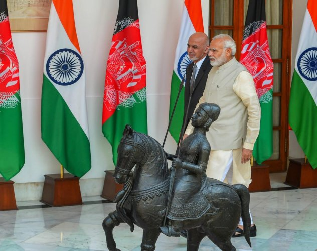 Prime Minister Narendra Modi (R) and Afghanistan President Ashraf Ghani ahead of a meeting at Hyderabad House, in New Delhi. PTI