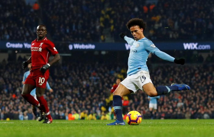Leroy Sane scores Manchester City's second goal in the English Premier League game against Liverpool on Thursday. REUTERS