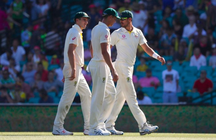 Australian pacers Pat Cummins (left), Josh Hazlewood (centre) and Mitchell Starc weren't happy with skipper Tim Paine's tactics on the first day of the fourth Test. AFP