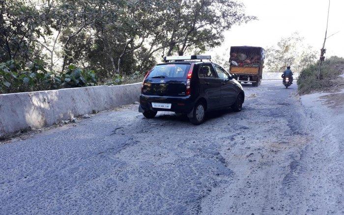 The pothole-ridden Charmadi Ghat in Mudigere taluk.