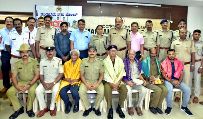 Traffic Wardens Joe Gonsalves, Francis Maxim Moras and Joseph D'Souza, Police Commissionerate staff Varun Alva, Yusuf , Purushottam and others were felicitated on the occasion of the completion of 100th edition of the phone-in programme conducted by the c