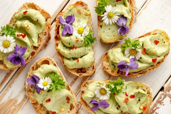 Avocado toast with a garnish of edible flower is a popular item.