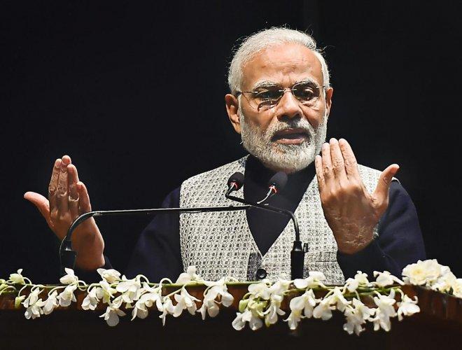 New Delhi: Prime Minister Narendra Modi addresses after releasing a commemorative coin in honour of Bharat Ratna Atal Bihari Vajpayee, in New Delhi, Monday, Dec 24, 2018. (PTI Photo/Kamal Singh)(PTI12_24_2018_000012A)