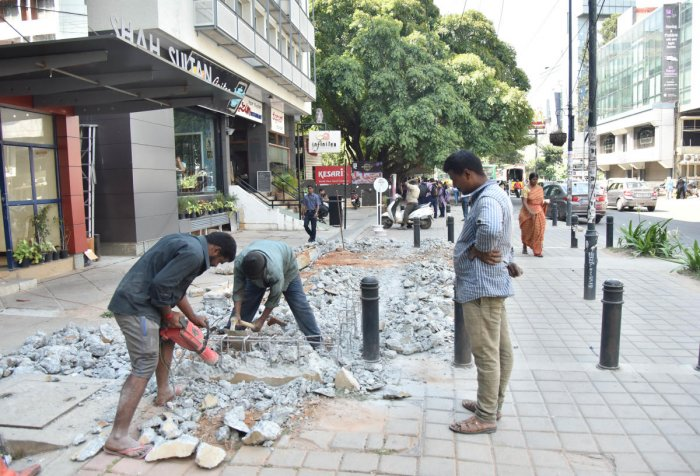 Workers of private company destroying the TenderSURE footpath in front of Shah Sultan building at Cunningham road in Bengaluru on Saturday 27th October 2018. Photo by Janardhan B K