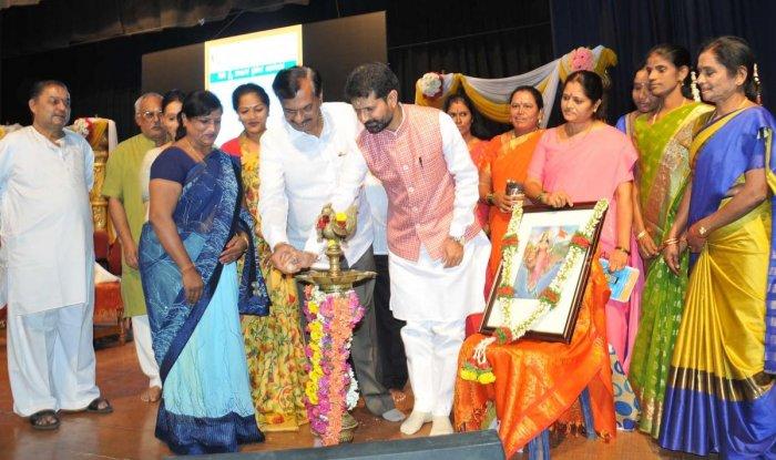 MLC Ayanur Manjunath, MLA C T Ravi and Pallavi C Ravi take part in the inauguration of the quarterly convention of anganwadi and Asha workers at Chikkamagaluru on Sunday.